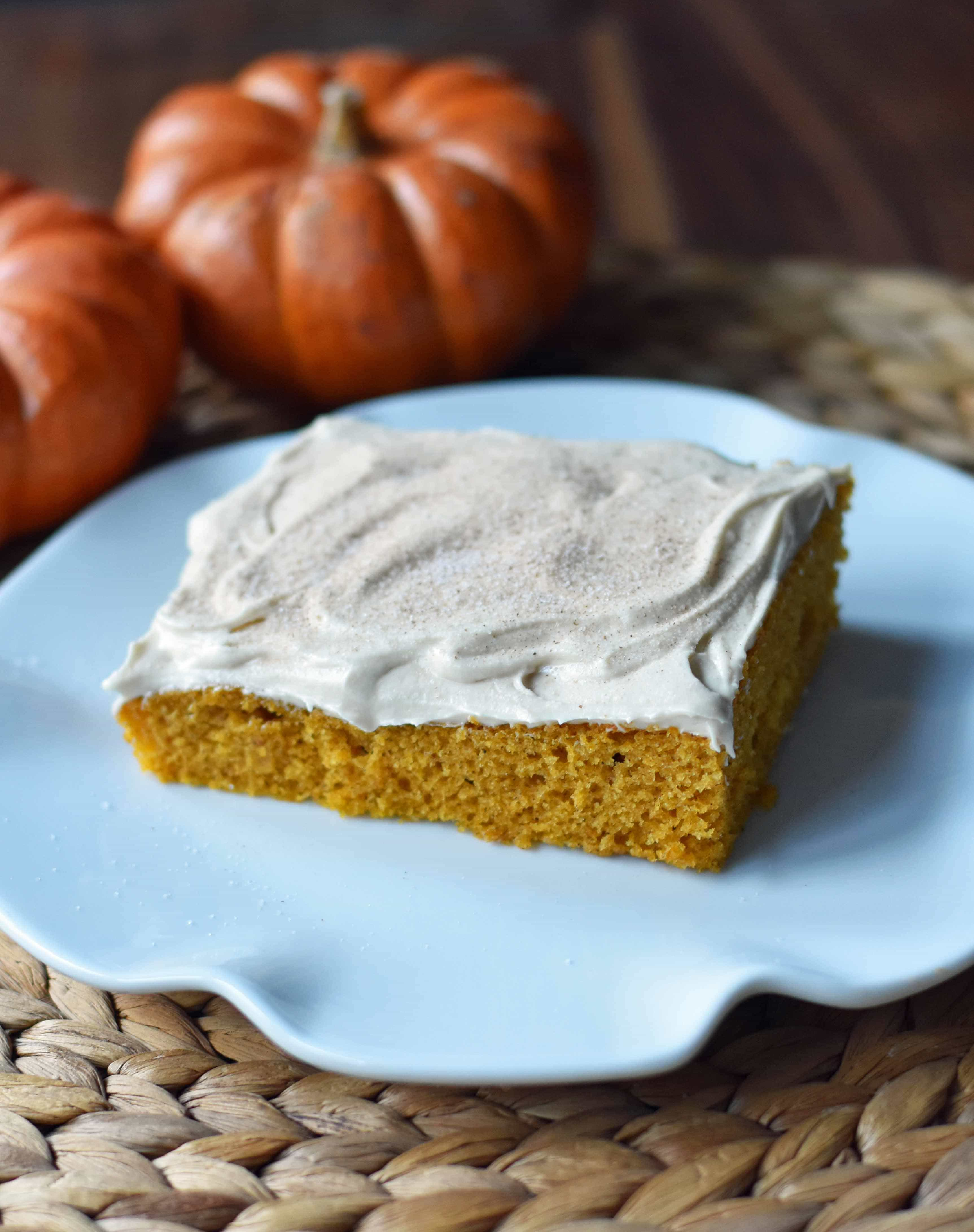 Pumpkin Sheet Cake with Cream Cheese Frosting. A pumpkin spice cake with a creamy homemade cream cheese frosting. A super simple, easy cake recipe! www.modernhoney.com