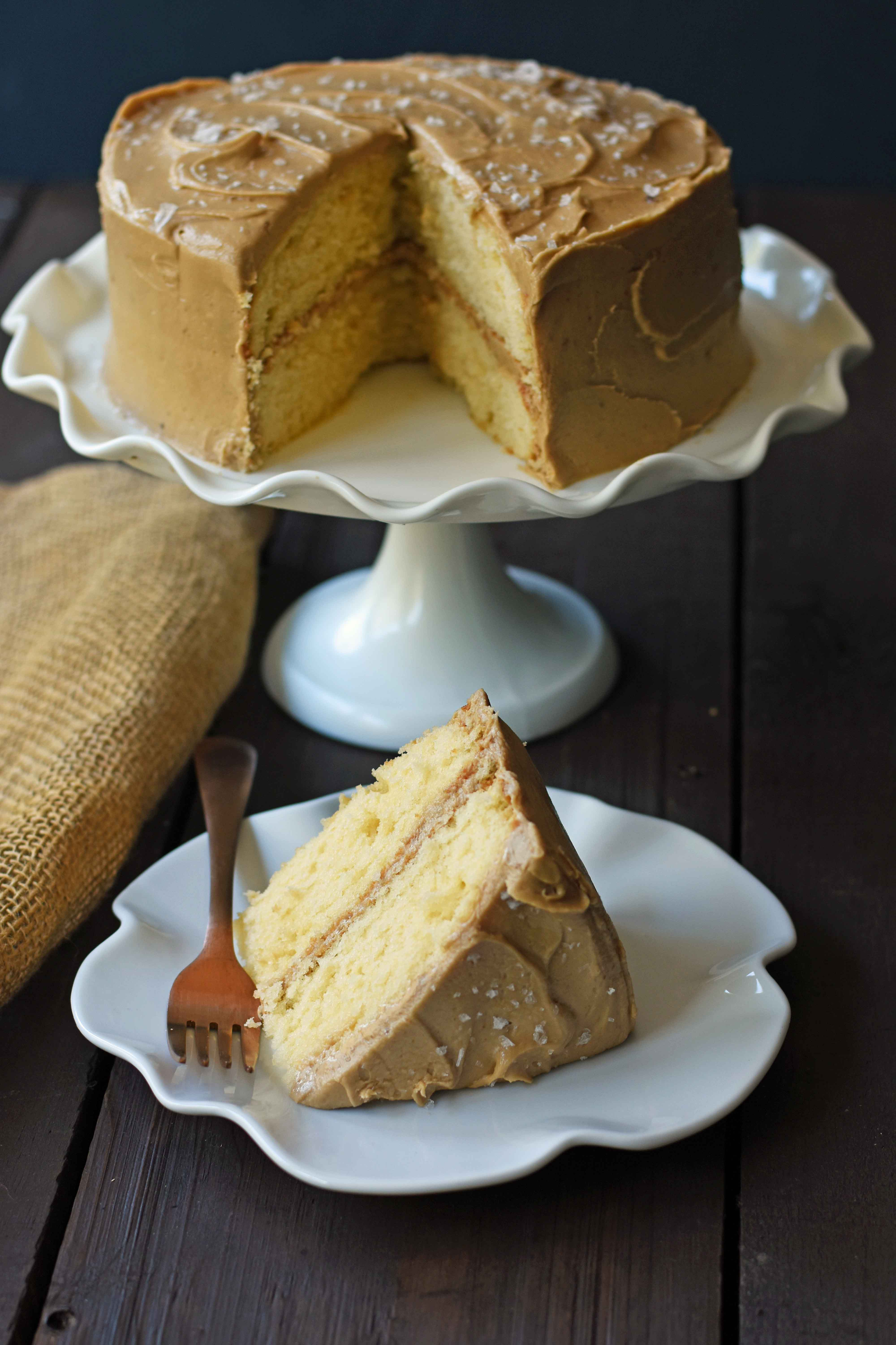 Southern Caramel Cake with Salted Caramel Frosting. A moist and fluffy yellow cake with sea salt caramel frosting. A Southern favorite cake! www.modernhoney.com