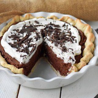 Chocolate Cream Pie. A homemade rich chocolate silk pie with a homemade chocolate custard. The best chocolate cream pie. www.modernhoney.com #chocolatecreampie #chocolatepie #pie #pierecipes #chocolate