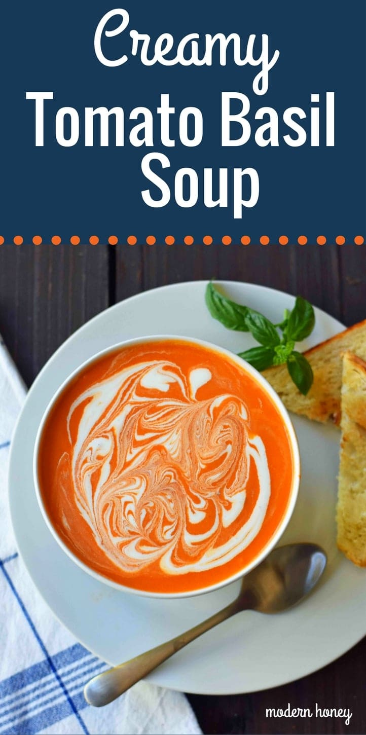 Creamy Tomato Basil Soup is the best cream of tomato soup. This Creamy Tomato Basil Soup Recipe using sauteed onions, garlic, tomatoes, chicken broth, basil, and heavy cream. You will never eat canned tomato soup again! The best creamy tomato soup recipe. www.modernhoney.com