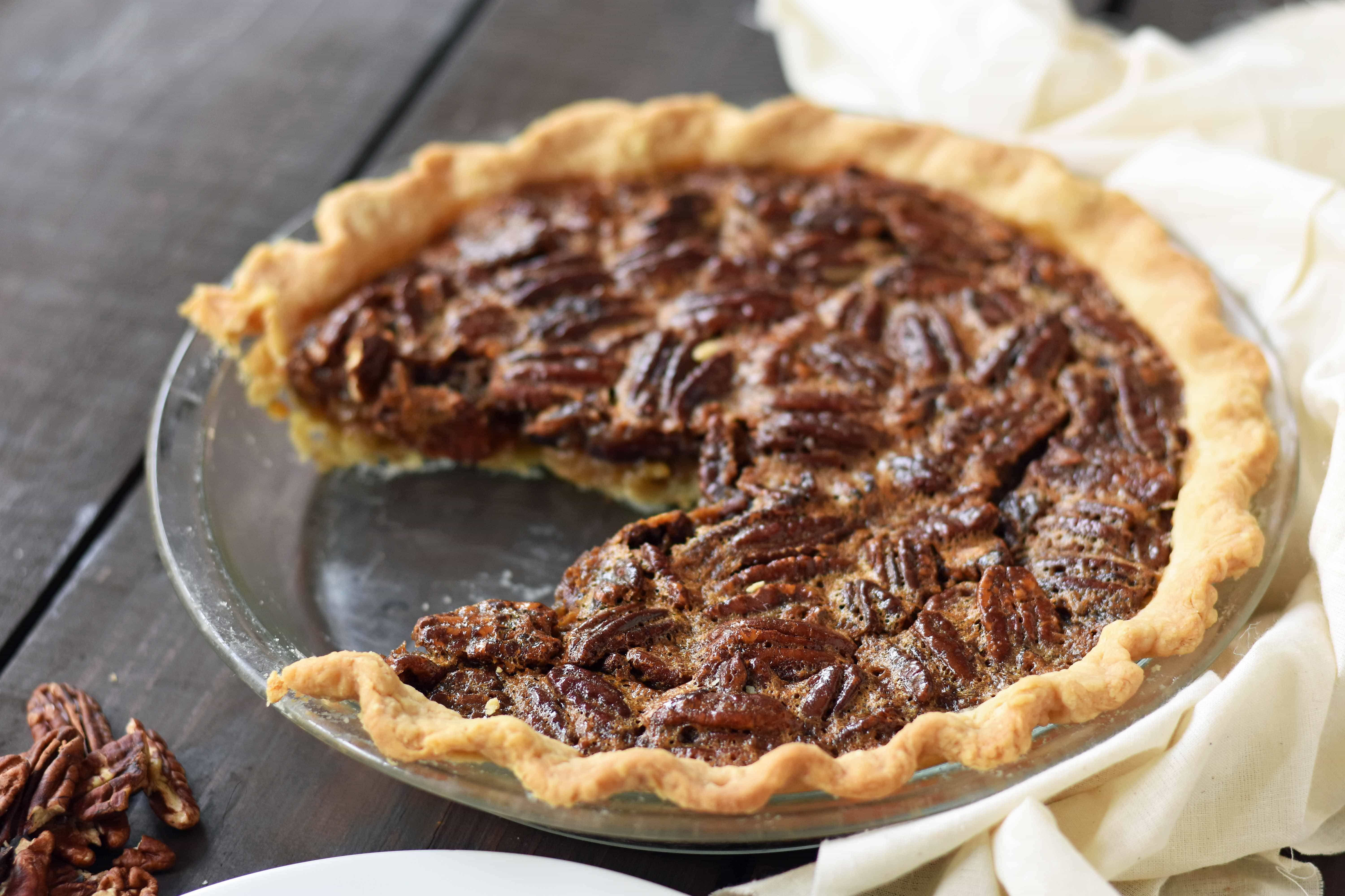 Old-Fashioned Pecan Pie made with a silky smooth brown sugar butter filling with crunchy pecans. Baked in a buttery flaky pie crust and topped with homemade whipped cream. A classic Southern Pecan Pie recipe. www.modernhoney.com