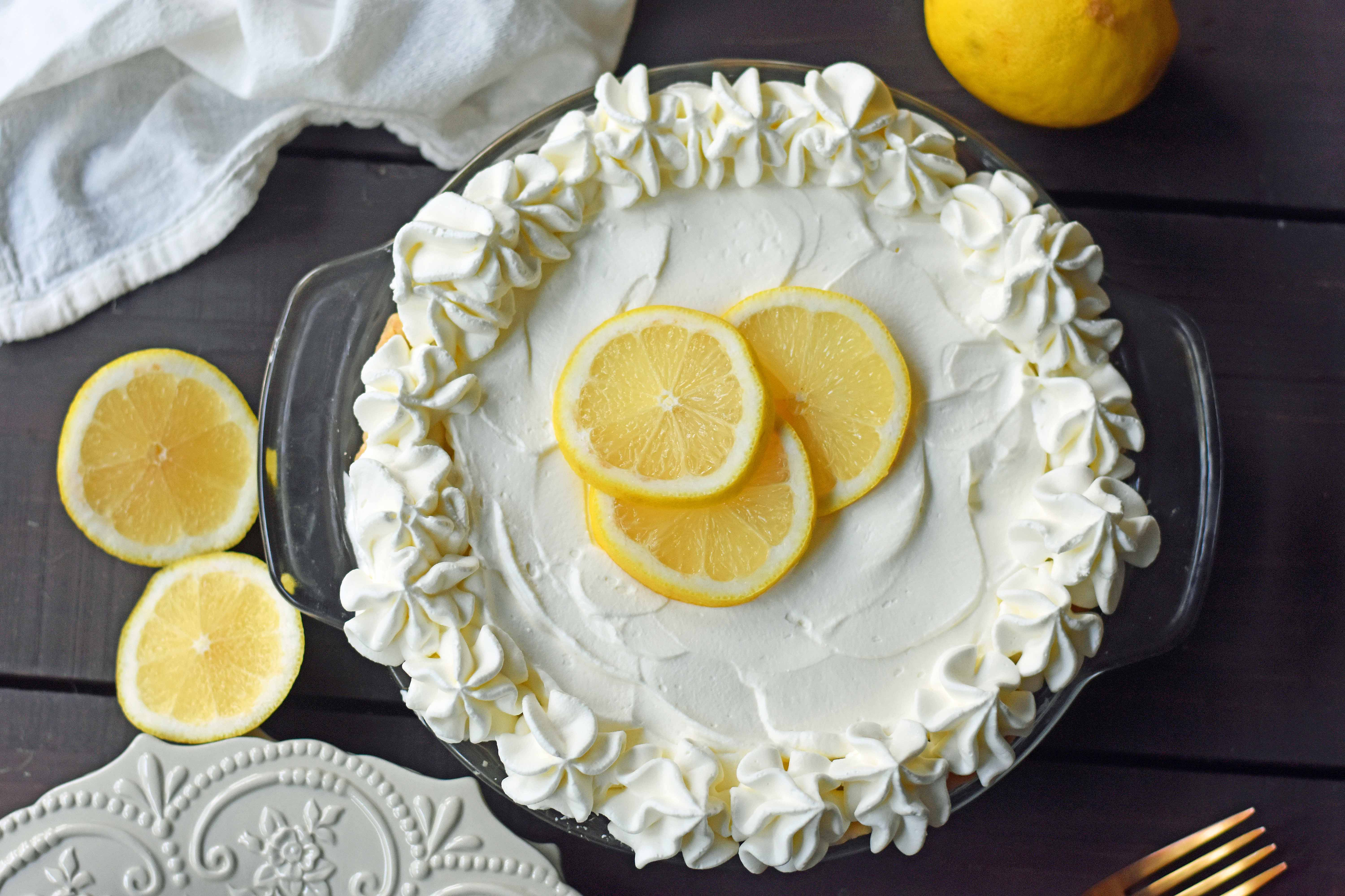 Sweet Lemon Sour Cream Pie made with freshly squeezed lemon juice, sugar, eggs, and sour cream to make it rich and creamy. All topped with homemade whipped cream in a buttery, flaky crust