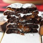 Caramel Filled Chocolate Crinkle Cookies. Soft chewy chocolate cookies with soft caramel center and roll into powdered sugar. A popular chocolate caramel filled cookie. www.modernhoney.com