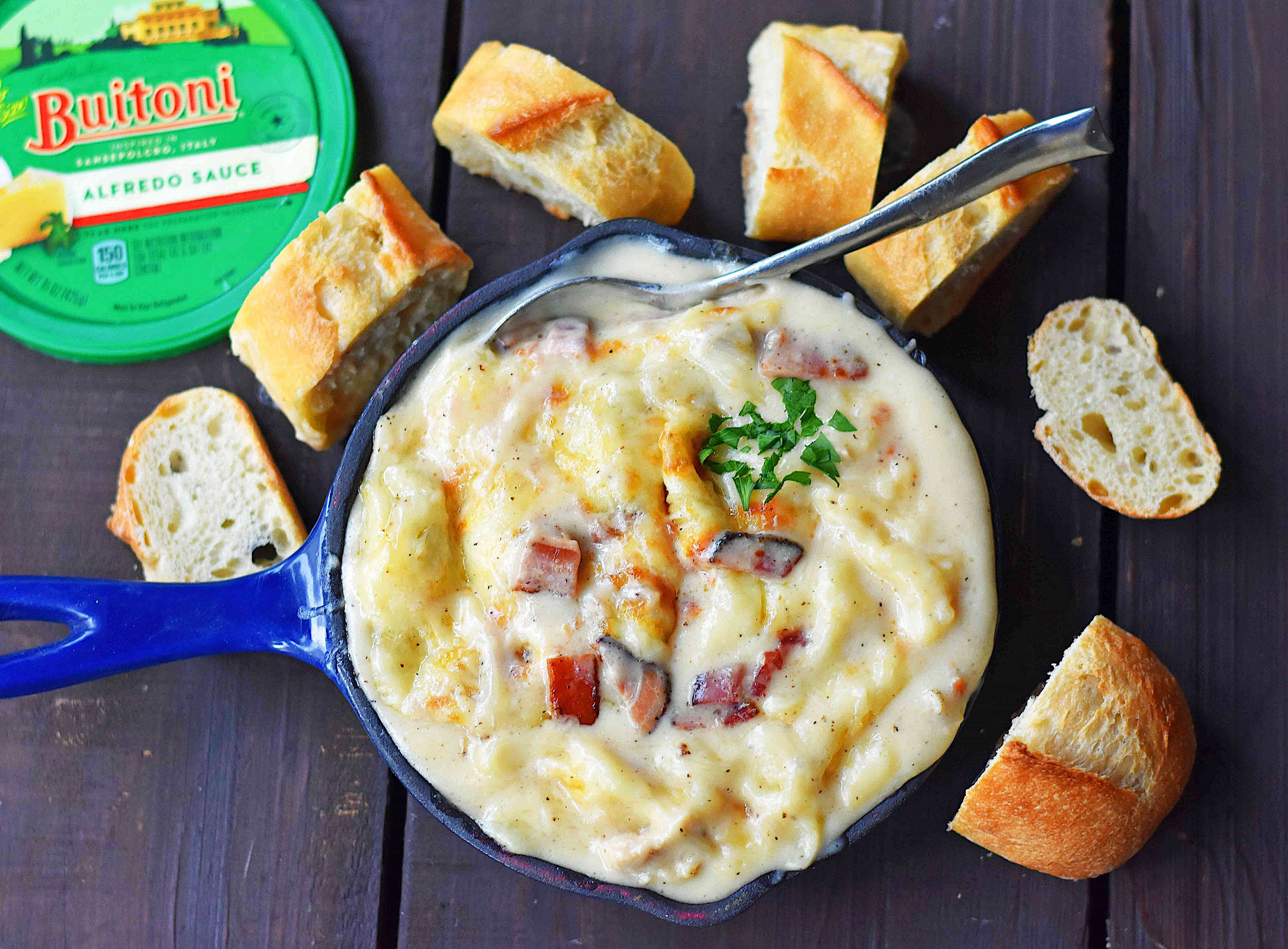 Chicken Bacon Alfredo Dip with Sautéed Chicken, Buitoni Alfredo Sauce, Crispy Bacon and baked with Mozzarella and Buitoni Parmesan Cheese. Served with sliced French Bread. A savory and cheese-filled baked appetizer that will please the masses!