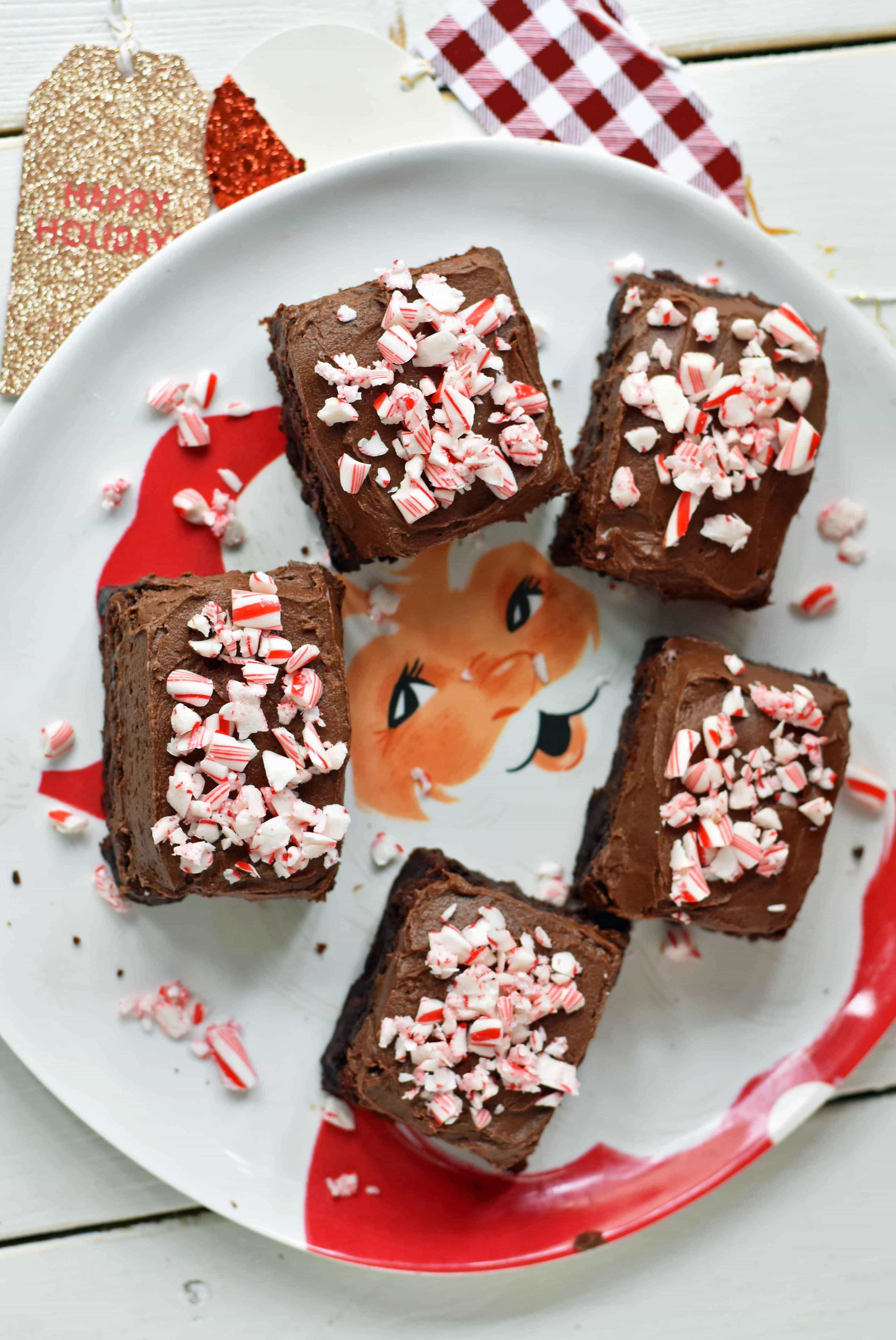 Peppermint Frosted Chocolate Brownies. Rich decadent chewy chocolate brownies topped with homemade silky smooth chocolate frosting and topped with candy canes. A chocolate frosted brownie with candy canes. www.modernhoney.com