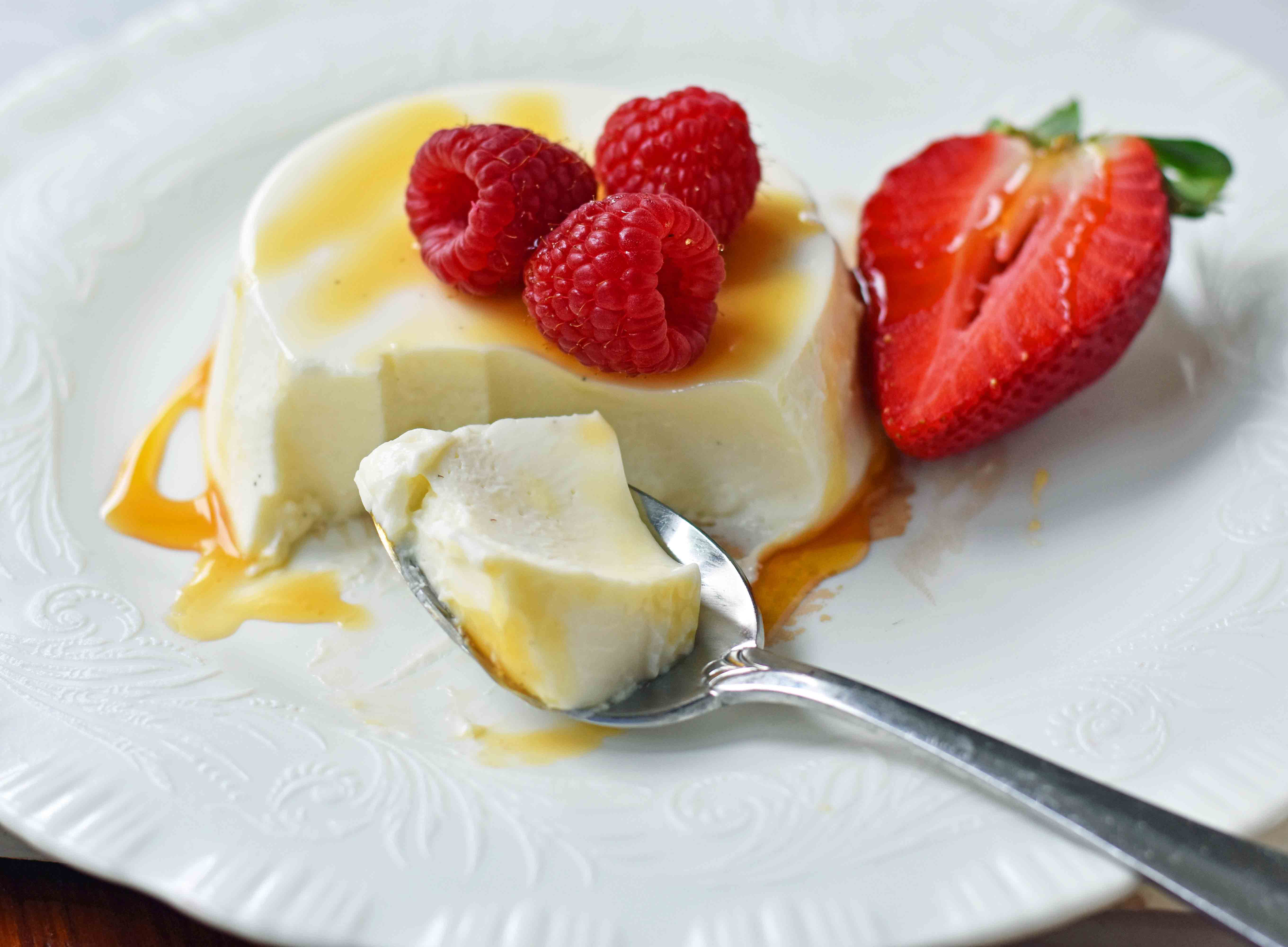 Greek Yogurt Panna Cotta. An easy panna cotta recipe made with greek yogurt, cream, sugar, honey, gelatin and vanilla bean. A silky smooth, creamy dessert that can be topped with fresh fruits, honey, caramel, berry compote or sauce, or anything you can dream up. The perfect panna cotta recipe. www.modernhoney.com