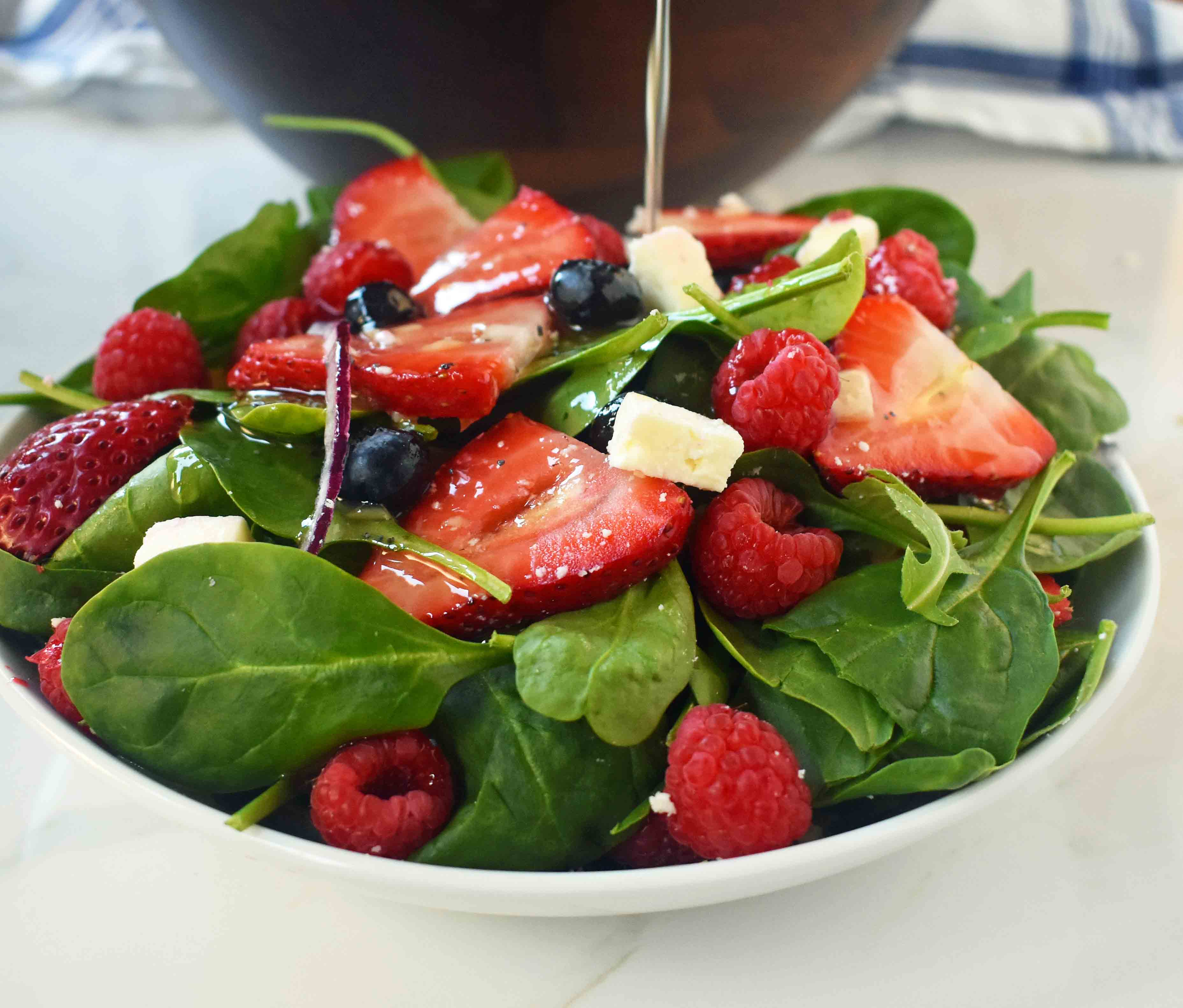 Spinach Berry Salad with Sweet Poppyseed Dressing. Fresh Spinach Salad with Berries, Feta Cheese, and Poppy Seed Dressing. www.modernhoney.com