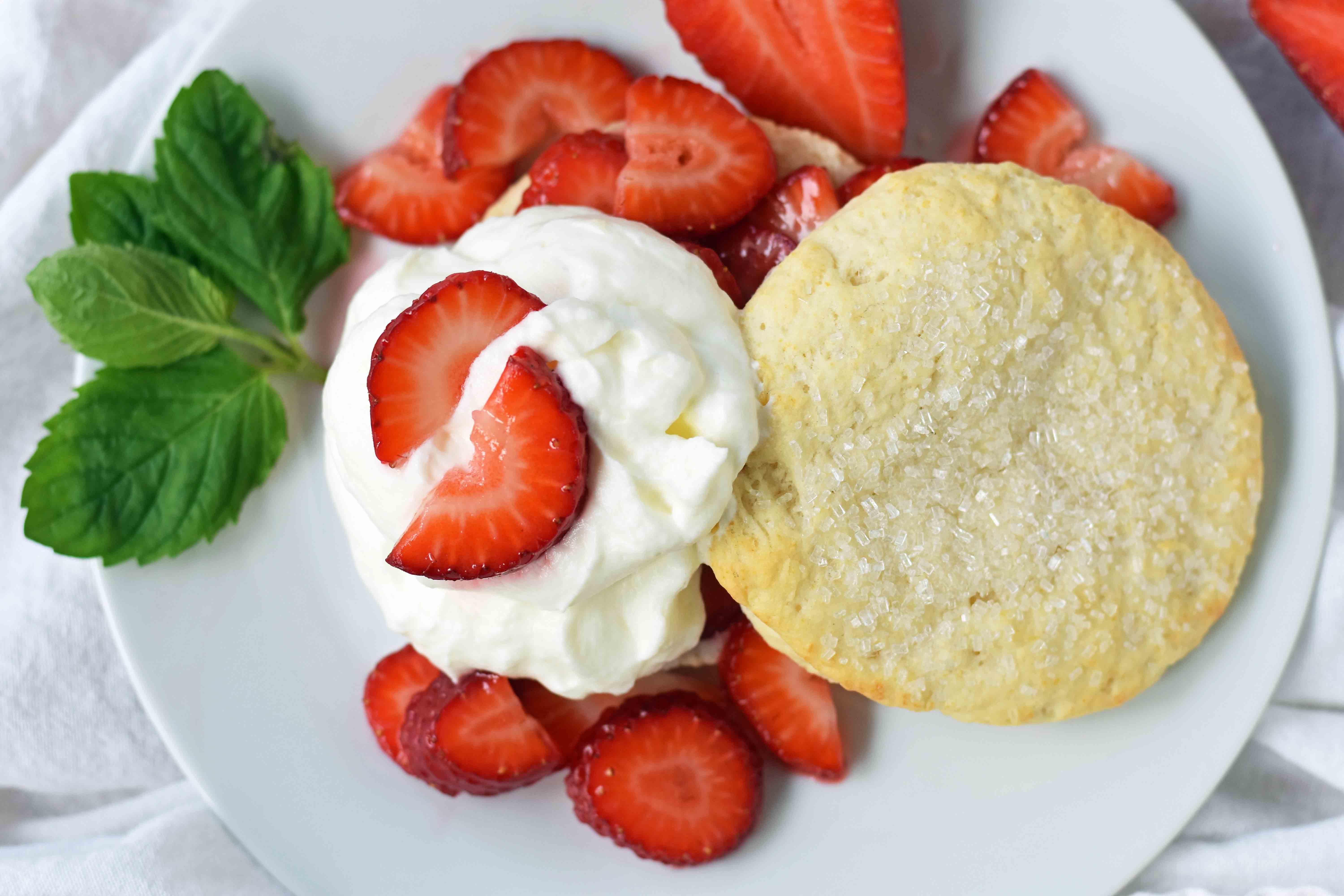 Strawberry Shortcake with Sweet Biscuits, Sugared Strawberries, and Homemade Sweetened Whipped Cream. The BEST Strawberry Shortcake Recipe. A Southern classic Strawberry Shortcake with biscuits. www.modernhoney.com