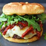 Brie Burger with Caramelized Onions and Sundried Tomatoes The Ultimate Burger with melted Brie Cheese, Sundried Tomatoes, Queen Creek Olive Mill Caramelized Red Onion Fig Tapenade, and Arugula. How to make the perfect burger. www.modernhoney.com