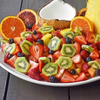 Summer Fruit Salad with Honey Lime Dressing. A healthy side dish! Vibrant fresh fruit with a citrus orange lime honey dressing. www.modernhoney.com