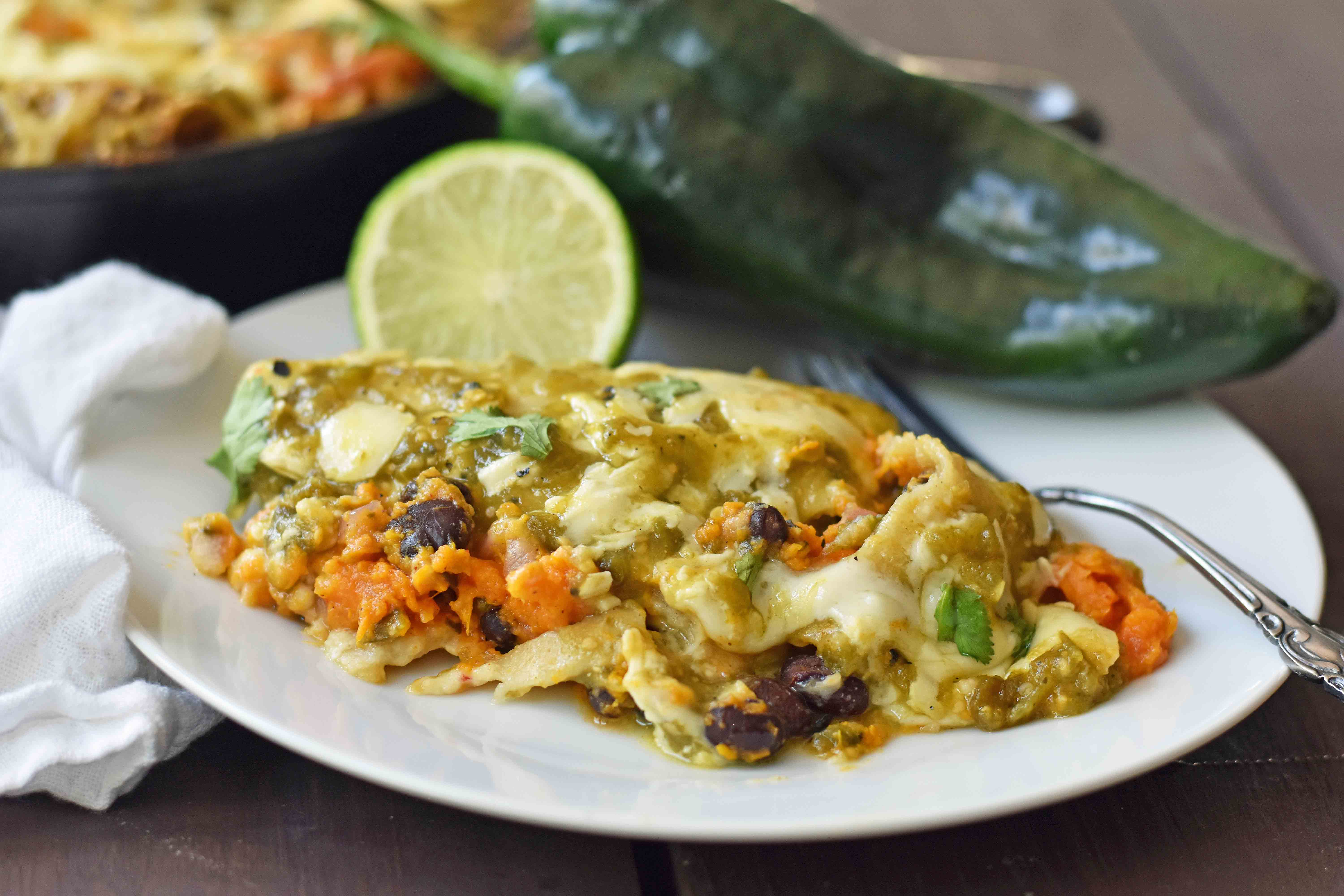 Sweet Potato Poblano Enchiladas. Vegetarian enchiladas with black beans, sweet potato, and poblano peppers topped with salsa verde and Mexican cheeses. A healthy comfort meal. www.modernhoney.com
