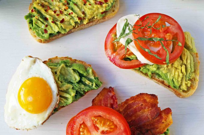 Avocado Toast -- 4 Ways. How to make perfect avocado toast. Caprese Avocado Toast, BAT Bacon Avocado Tomato Avocado Toast, Fried Egg Avocado Toast, Avocado Toast with Sea Salt and Chili Flakes. Tips and tricks for making the best avocado toast. www.modernhoney.com #avocadotoast #avocados #avocado