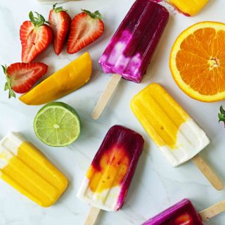 Homemade Fruit Popsicles Recipe. Fruit and Cream Popsicles. How to make homemade fruit and cream popsicles. Mango and Cream Popsicles. Pitaya and Cream Popsicles. Peaches and Cream Popsicles. Pitaya Strawberry Popsicles. www.modernhoney.com #popsicles #fruitpopsicles #fruitandcreampopsicles #homemadepopsicles