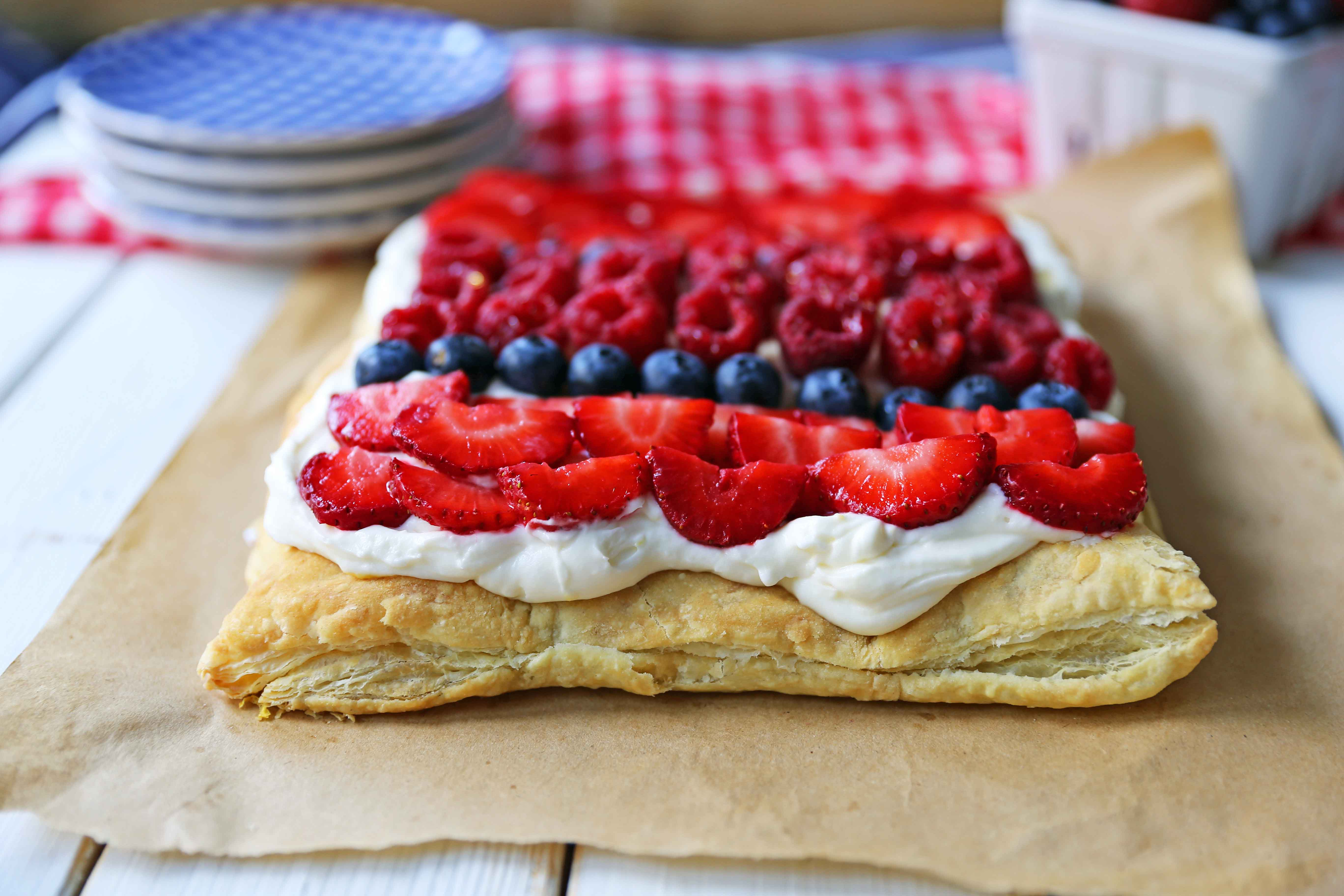 Lemon Berry Cheesecake Puff Pastry Baked Puff Pastry topped with Lemon Cheesecake Filling and Fresh Berries. An easy, beautiful, festive summer dessert.www.modernhoney.com