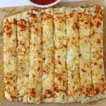 Cheese Focaccia Bread Recipe. How to make garlic cheese focaccia bread from scratch. The best garlic cheese breadsticks. www.moderhoney.com #focaccia