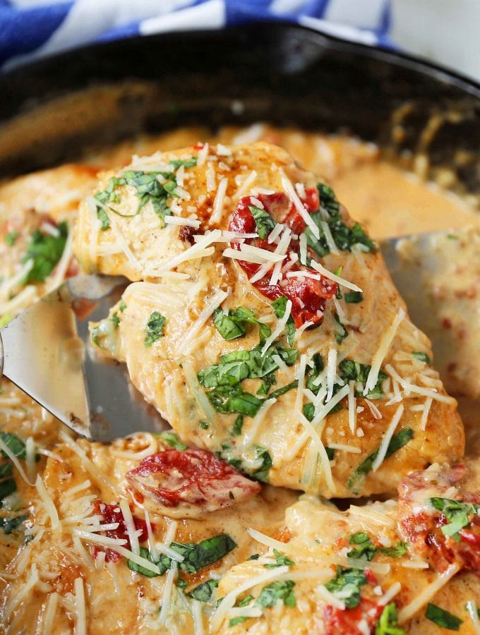 Skillet Chicken with Sun-Dried Tomato Cream Sauce. 20-Minute Chicken made with garlic butter sun-dried tomato parmesan cheese cream sauce. The most flavorful chicken and sauce! You will want to drink the sauce...its THAT GOOD! www.modernhoney.com