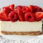 The BEST Creamy Cheesecake Bars. Homemade cheesecake squares with fresh berries. How to make the perfect cheesecake bars. #cheesecake #cheesecakebars #creamcheesedesserts