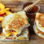 Honey Peach White Cheddar Grilled Cheese Sandwich. A summer grilled cheese sandwich with sweet juicy peaches, white cheddar cheese, a drizzle of honey on buttery toasted bread. www.modernhoney.com #peaches #grilledcheese #peachgrilledcheese