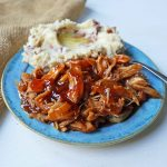 Slow Cooker Peach Barbecue Sauce Chicken. 5-Ingredient Crockpot Chicken with Sweet Peach BBQ Glaze. A fast and flavorful slow cooker chicken with peach bbq sauce. www.modernhoney.com #slowcooker #crockpot