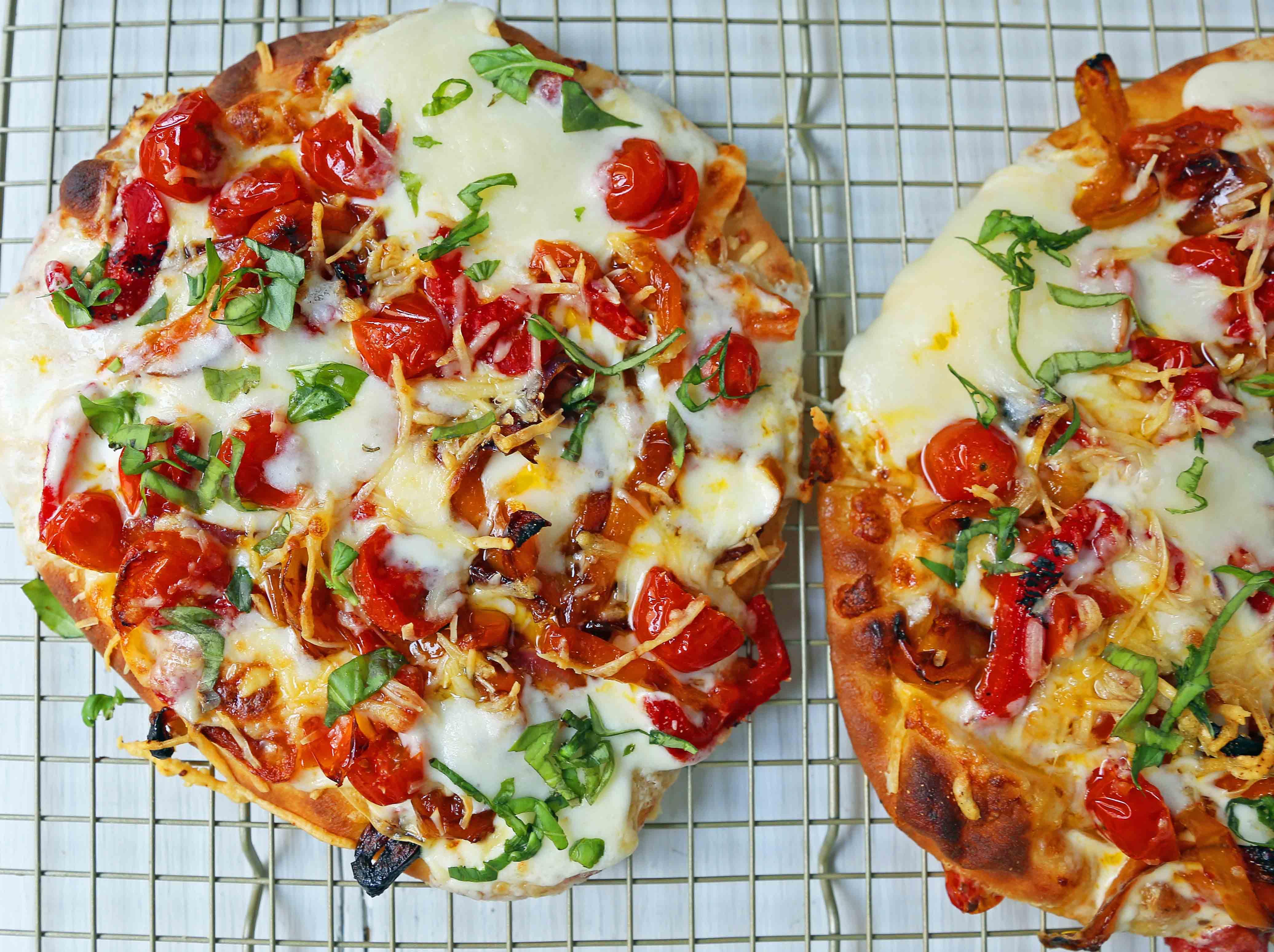 Veggie Pizza Recipe. Homemade veggie pizza with roasted vegetables, mozzarella cheese, and ricotta. Naan Bread Pizza made in 20 minutes! www.modernhoney.com #flatbreadpizza #naanbreadpizza
