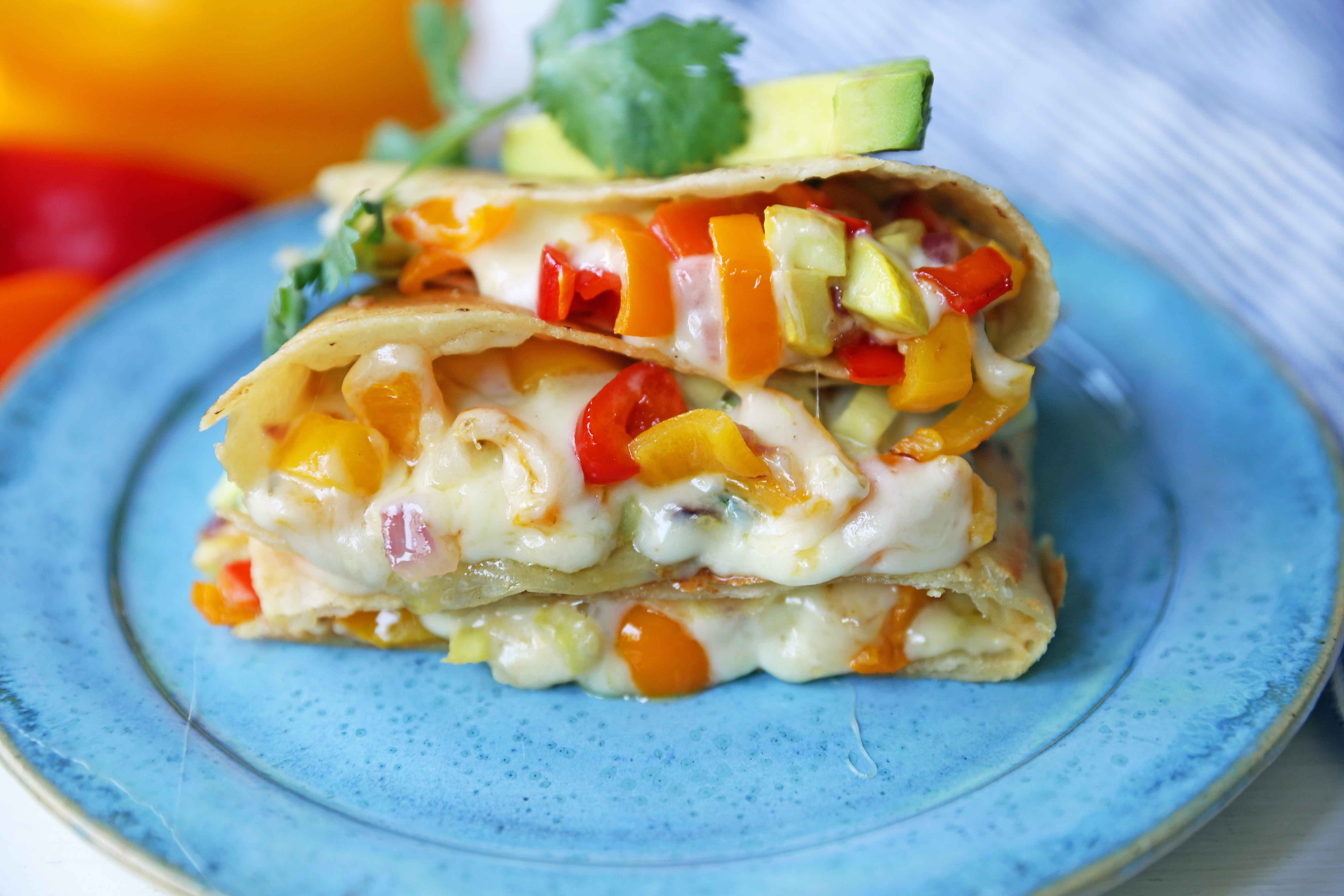 Veggie Quesadilla Recipe. Summer veggies with ooey gooey melted cheese in a buttery golden tortilla. The best veggie quesadilla recipe. www.modernhoney.com #veggiequesadilla #vegetarian #vegetarianrecipe