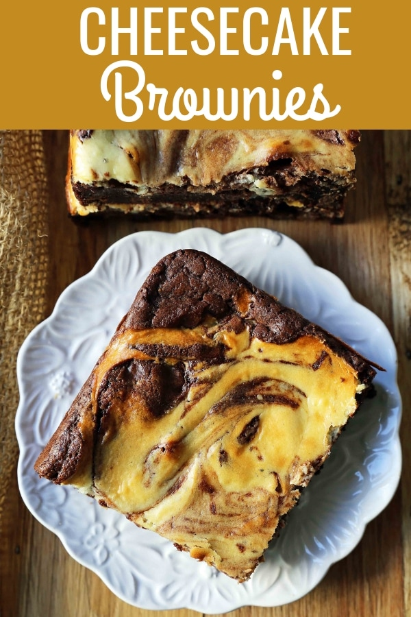 Cheesecake Brownies Homemade double chocolate chunk brownies with a sweet and tangy cheesecake swirl. Cheesecake and a Brownie in one dessert bar! Cream Cheese Brownies Recipe. www.modernhoney.com #creamcheesebrownies #cheesecakebrownies #brownies #cheesecakebrownierecipe #homemadebrownies