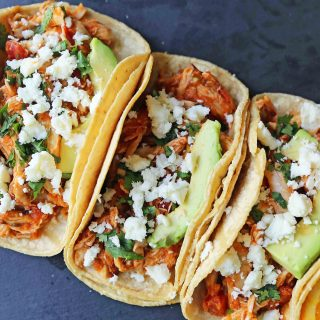 Chipotle Chicken Tinga Tacos. A simple, quick, and easy chicken taco recipe. One skillet chicken taco recipe. www.modernhoney.com #chickentinga #chipotlechicken #chickentacos #chickentingatacos