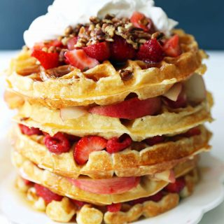 One Bowl Easy Buttermilk Waffles. Quick waffle recipe which creates chewy, crispy, and buttery waffles. The perfect waffle recipe. www.modernhoney.com #waffles #wafflerecipe #buttermilkwaffles #buttermilkwaffle