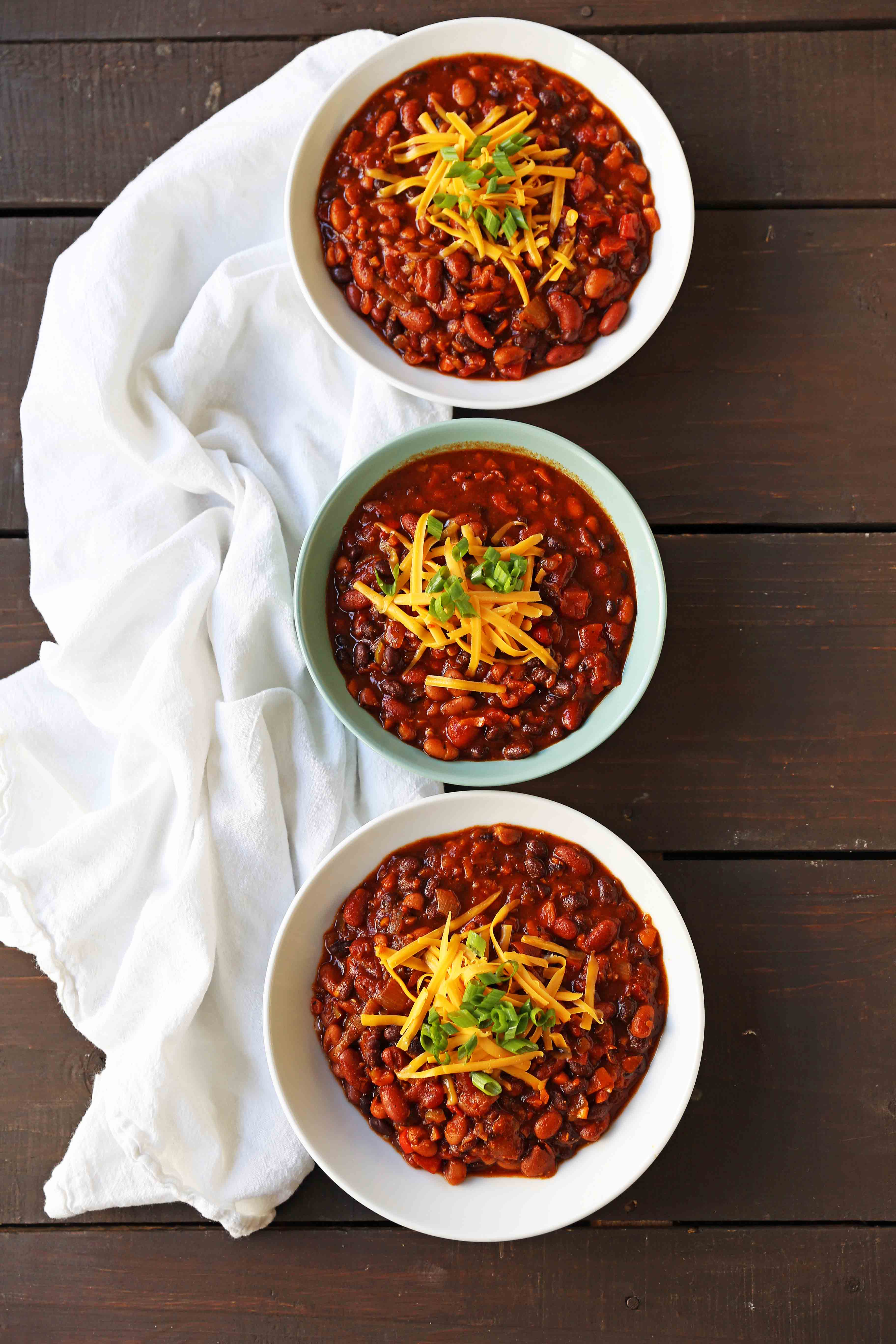 Veggie Chili Recipe. A healthy vegetable and bean filled chili in a spicy tomato sauce. The perfect Veggie Chili recipe and you won't even miss the meat! www.modernhoney.com #veggiechili #veggiechilirecipe #vegetarian #chili