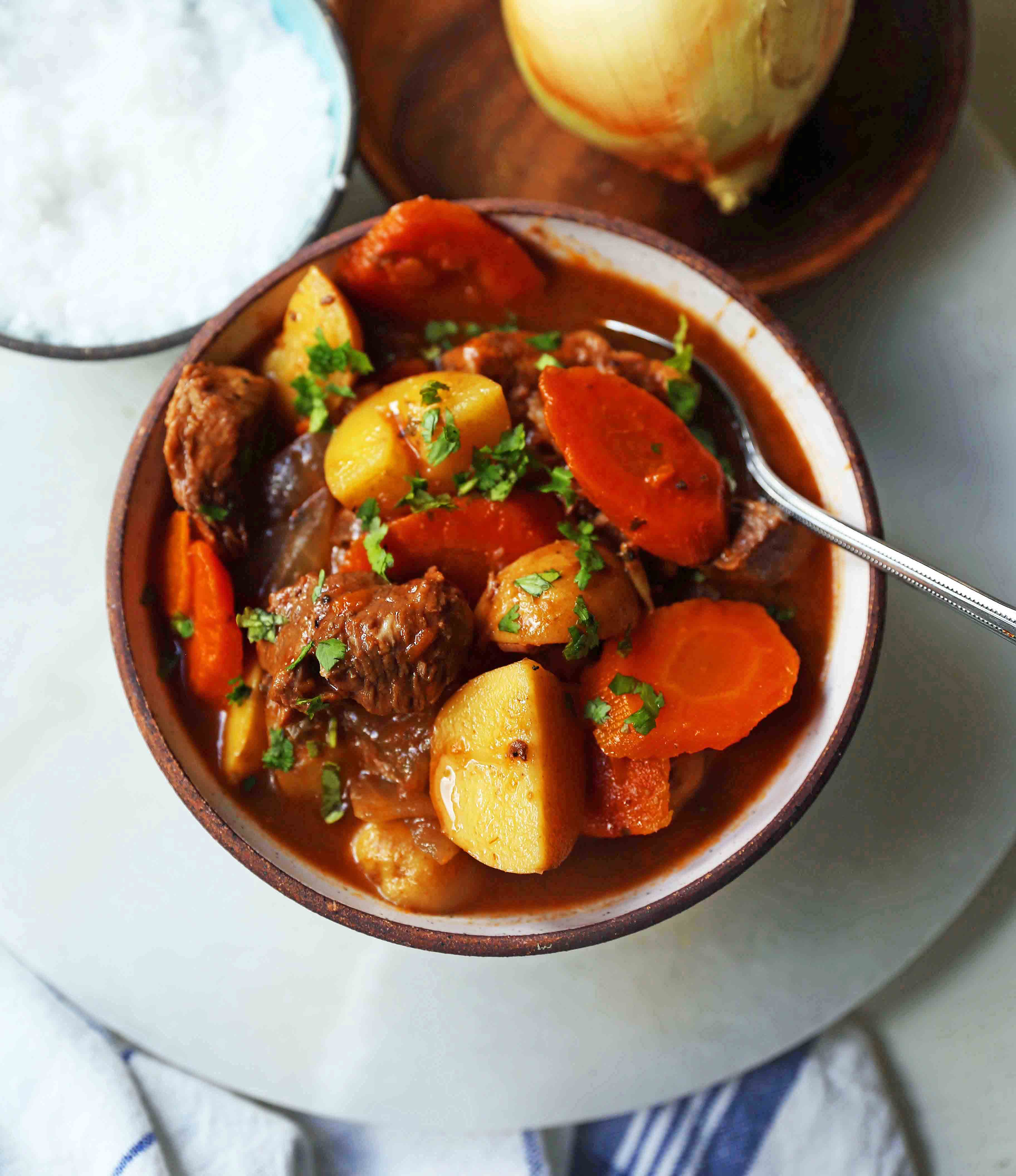 Hearty Beef Stew Recipe is the ultimate comfort food. A healthy beef stew recipe using lean beef, yukon gold potatoes, carrots, onions, in a rich broth. The perfect beef stew recipe! www.modernhoney.com #beefstew #beefstewrecipe #beefsoup #homemadebeefstew #comfortfood #Kroger