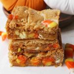 Candy Corn Blondies. Halloween Browned Butter Blondies with Candy Corn. A festive Halloween dessert bar. www.modernhoney.com #candycorns #candycorn #candycorndessert #candycornblondies #halloweenblondies #halloweendessert #halloweendesserts