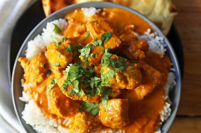 Chicken Tikka Masala A popular Indian dish with a spiced tomato cream based sauce with tender chicken and spices. Authentic Tikki Masala with Chicken Recipe. www.modernhoney.com #tikkamasala #chickentikkamasala #indianfood #indiancurry #indianchickencurry #comfortfood