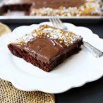 The Best Chocolate SHEET Cake with Milk Chocolate Frosting. Quick and easy homemade chocolate sheet cake recipe. www.modernhoney.com #chocolatesheetcake #sheetcake #chocolatesheetcakerecipe