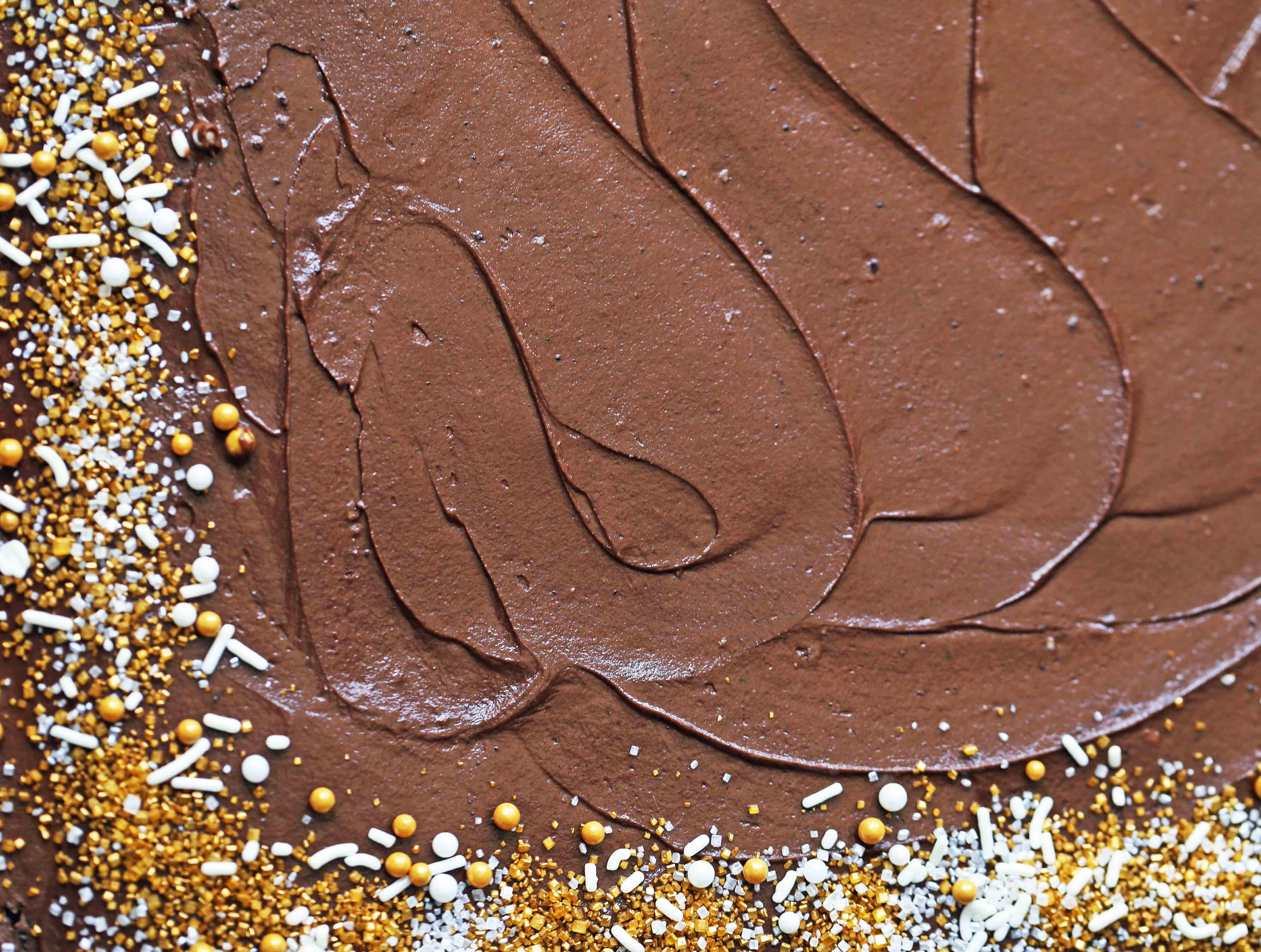 The Best Chocolate SHEET Cake with Milk Chocolate Frosting. Quick and easy homemade chocolate sheet cake recipe. www.modernhoney.com #chocolatesheetcake #sheetcake #chocolatesheetcakerecipe