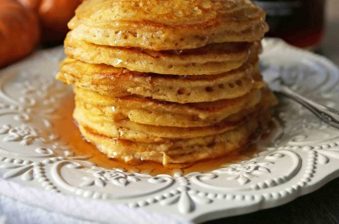 The BEST Pumpkin Pancakes. Light, fluffy, airy, and creamy pumpkin spiced pancakes. The perfect Fall breakfast. www.modernhoney.com #pumpkin #pumpkinpancakes #pumpkinrecipes #pumpkinbreakfast #fallbreakfast #pumpkinspice