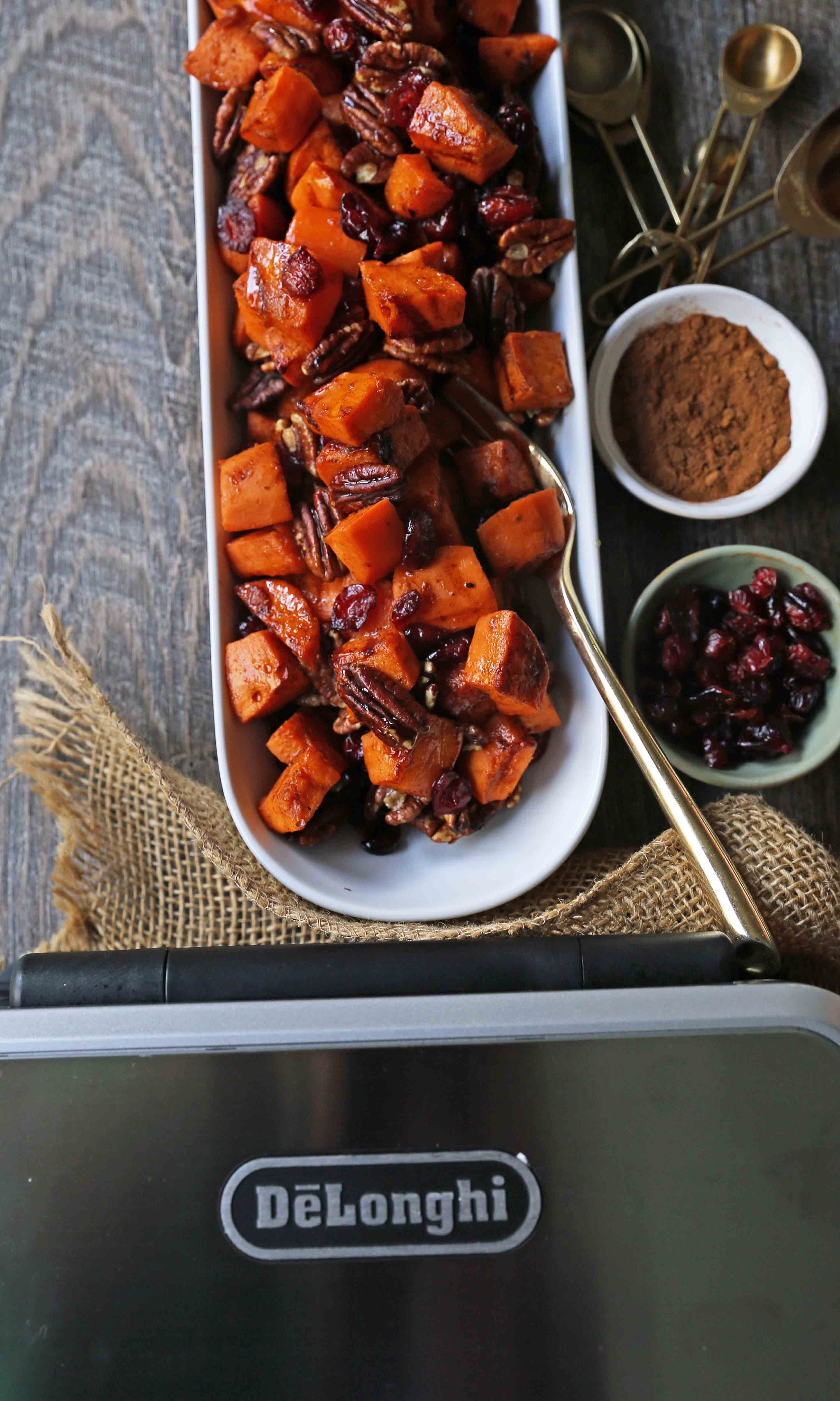 Roasted Sweet Potatoes with Pecans and Cranberries on the grill. An easy, healthy side dish made with cinnamon roasted sweet potatoes, toasted pecans, and sweet and tart dried cranberries. www.modernhoney.com #sidedish #sweetpotatoes #sweetpotatoespecan #roastedsweetpotatoes
