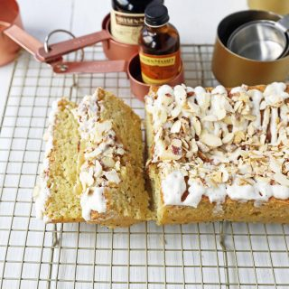 Almond Poppyseed Bread. Soft and moist poppyseed bread with vanilla bean almond glaze and candied almonds. The perfect poppyseed bread recipe. www.modernhoney.com #poppyseedbread #almondbread #quickbread