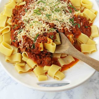 Beef Bolognese Sauce. Authentic Italian Beef Bolognese Sauce on top of fresh pasta is a warm, weeknight dish made in less than 30 minutes. www.modernhoney.com #italian #beefbolognese #pasta #spaghetti #italianfood