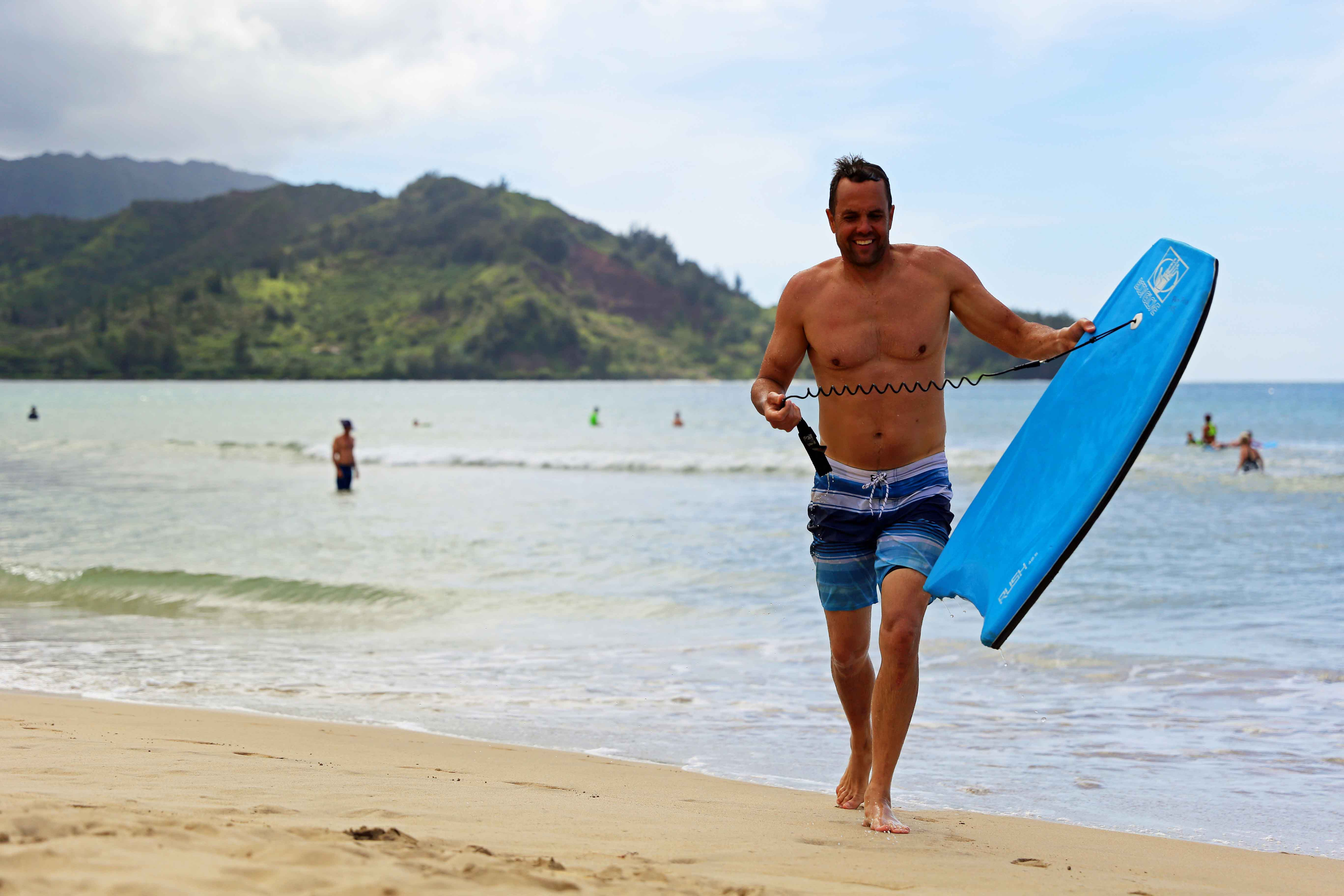Kauai Hawaii Travel Guide. Boogie Boarding at Hanalei Bay