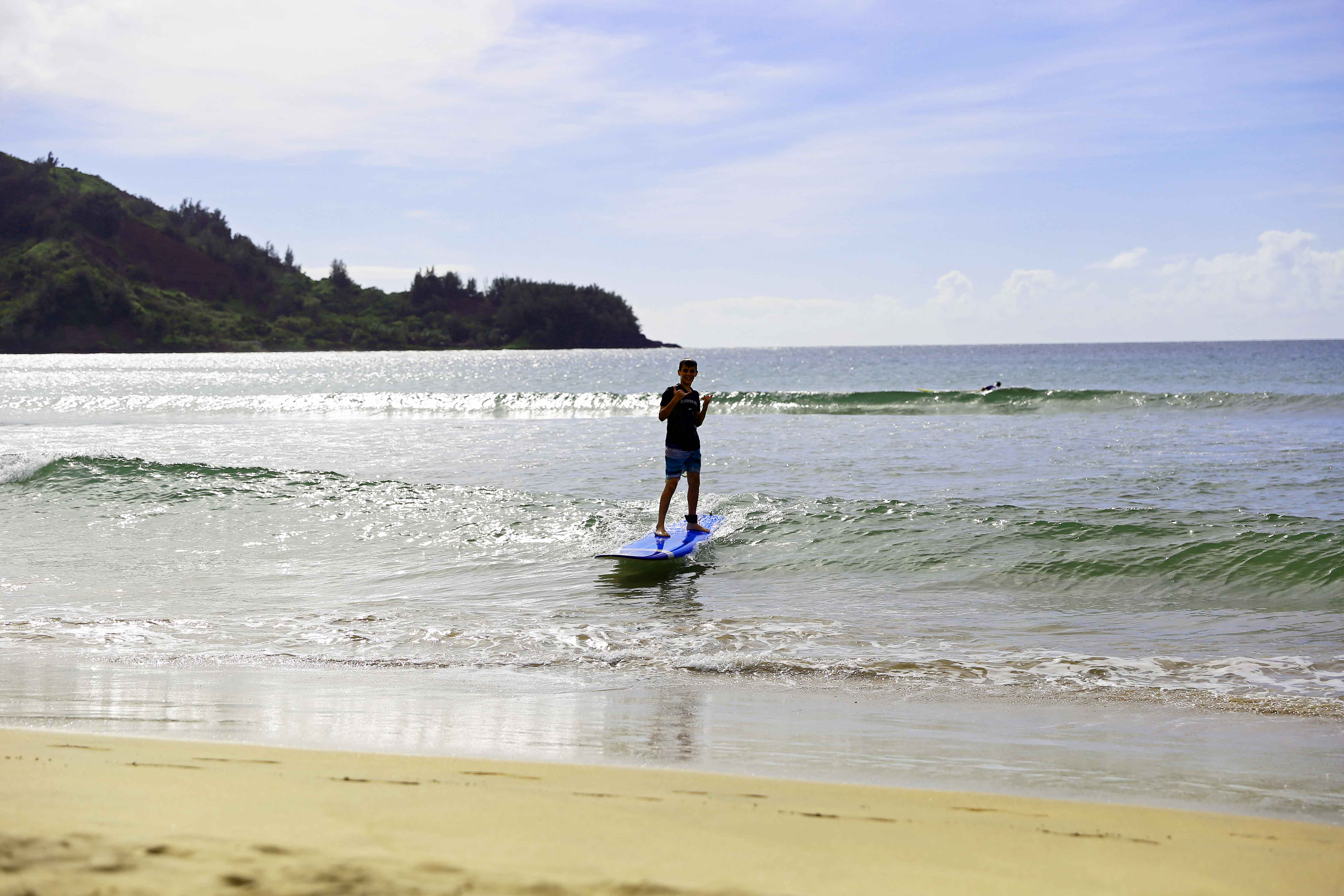Surfing at Hanalei Bay