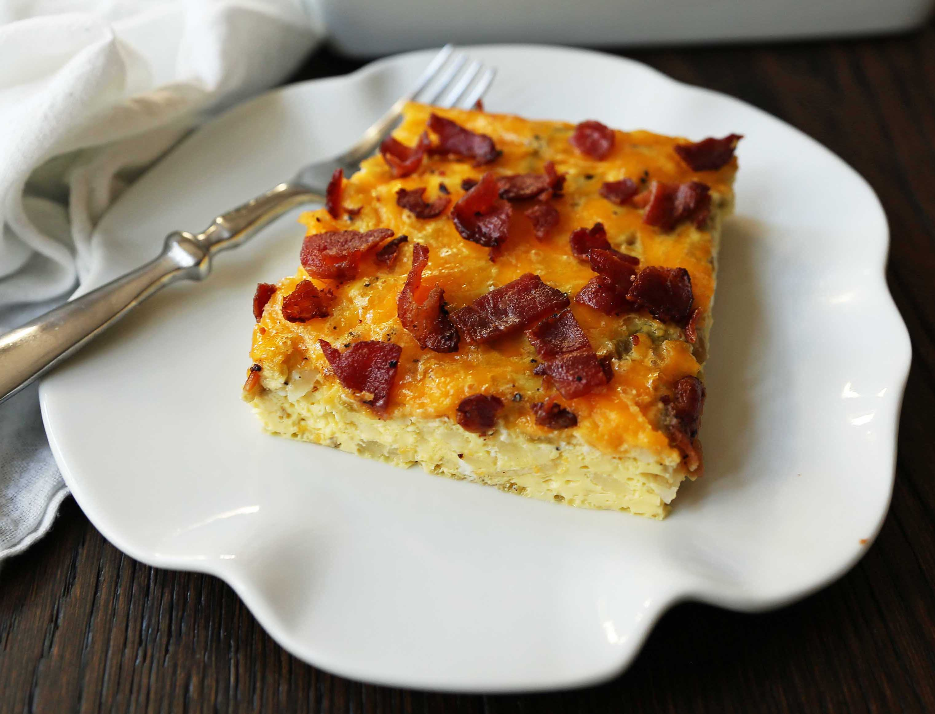 Bacon Egg and Cheese Casserole. An easy breakfast casserole recipe. Green Chili Bacon Cheese Egg Breakfast Souffle. www.modernhoney.com #breakfast #eggs #eggdish #eggcasserole #breakfastcasserole #christmas #christmasbreakfast #christmascasserole