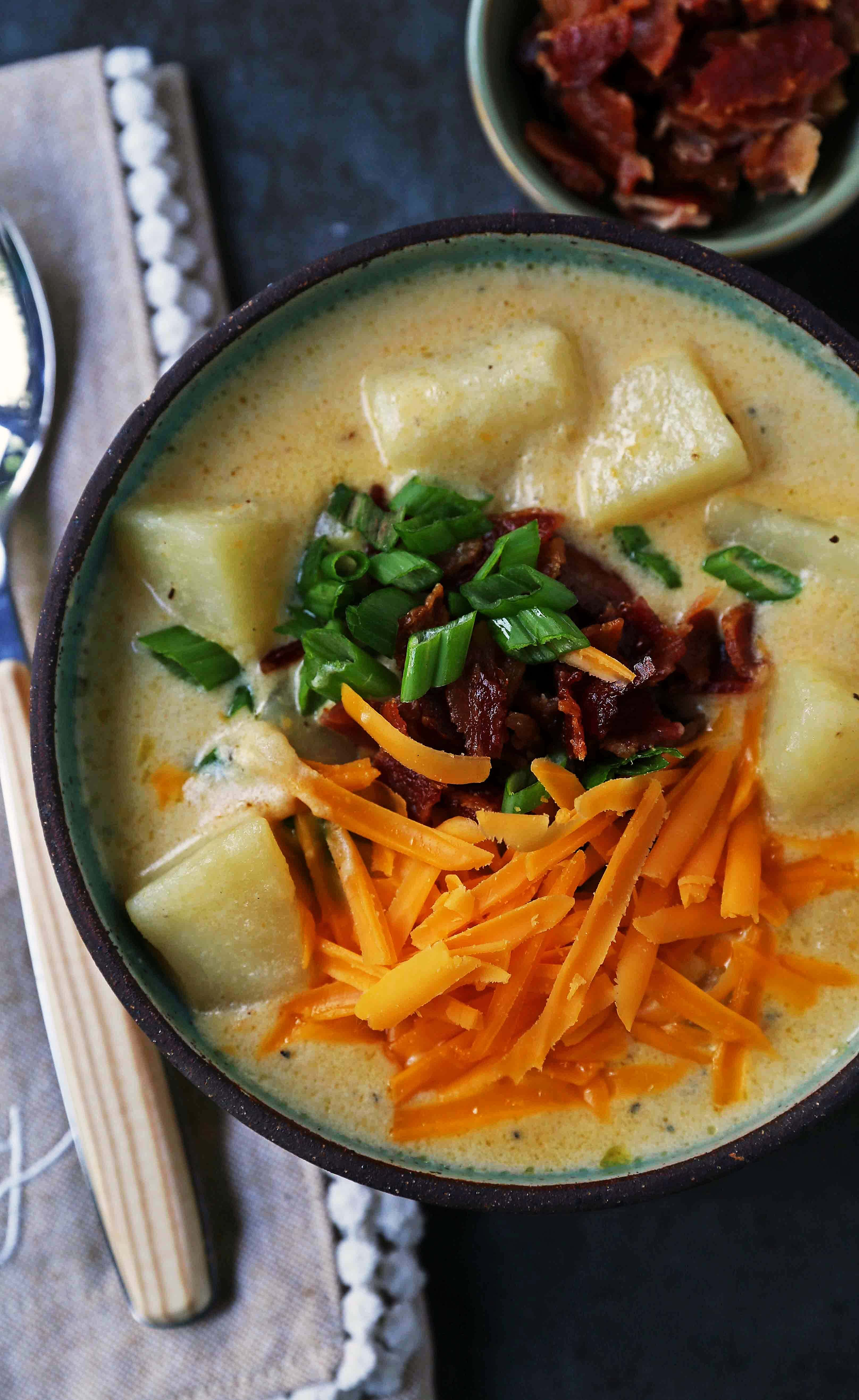 Loaded Baked Potato Soup. Creamy Cheesy Potato Soup topped with crispy bacon, green onions, sharp cheddar cheese, and sour cream. The perfect baked potato soup recipe. www.modernhoney.com #soup #soups #bakedpotatosoup #potatosoup #creamsoup www.modernhoney.com