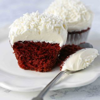 Red Velvet Cupcakes. The Best Red Velvet Cupcake Recipe with Cream Cheese Frosting. All of the tips and tricks for making perfect red velvet cupcakes every single time! www.modernhoney.com #redvelvet #redvelvetcupcakes #redvelvetcupcake