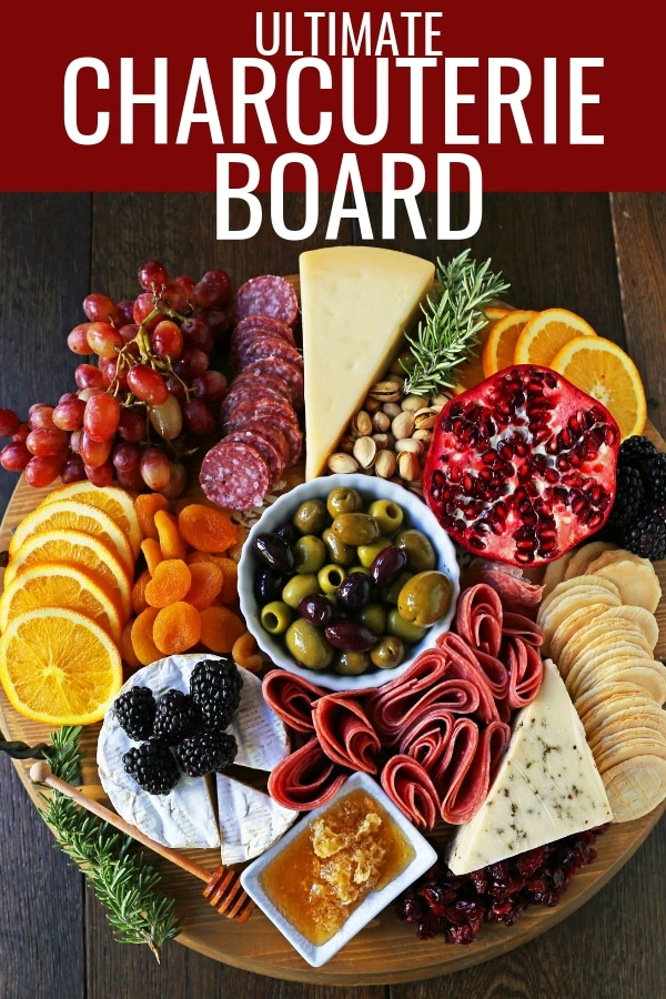 How to make an EPIC Charcuterie Board (AKA Meat and Cheese Platter). How to make a beautiful meat cheese and fruit platter. The perfect appetizer for your next party! www.modernhoney.com #meatboard #meatandcheeseboard #appetizer #appetizers #charcuterieboard #charcuterie #cheeseboard