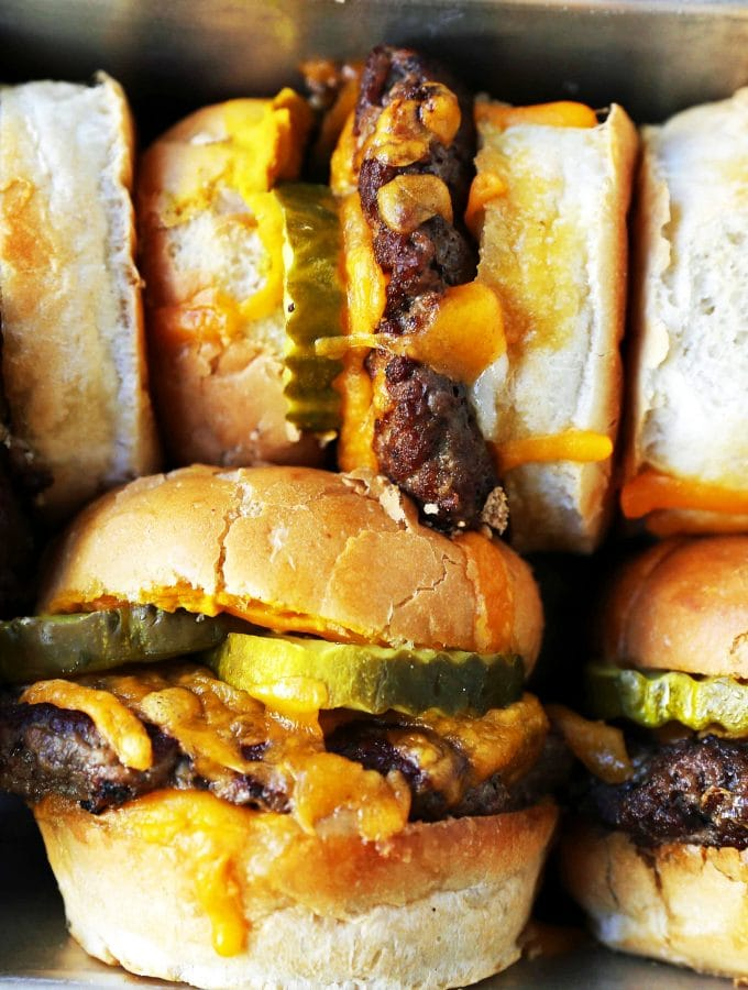 Cheeseburger Sliders. How to make the perfect cheese sliders. Super Bowl food. www.modernhoney.com #sliders #cheeseburgers #hamburgers #burgers #burger