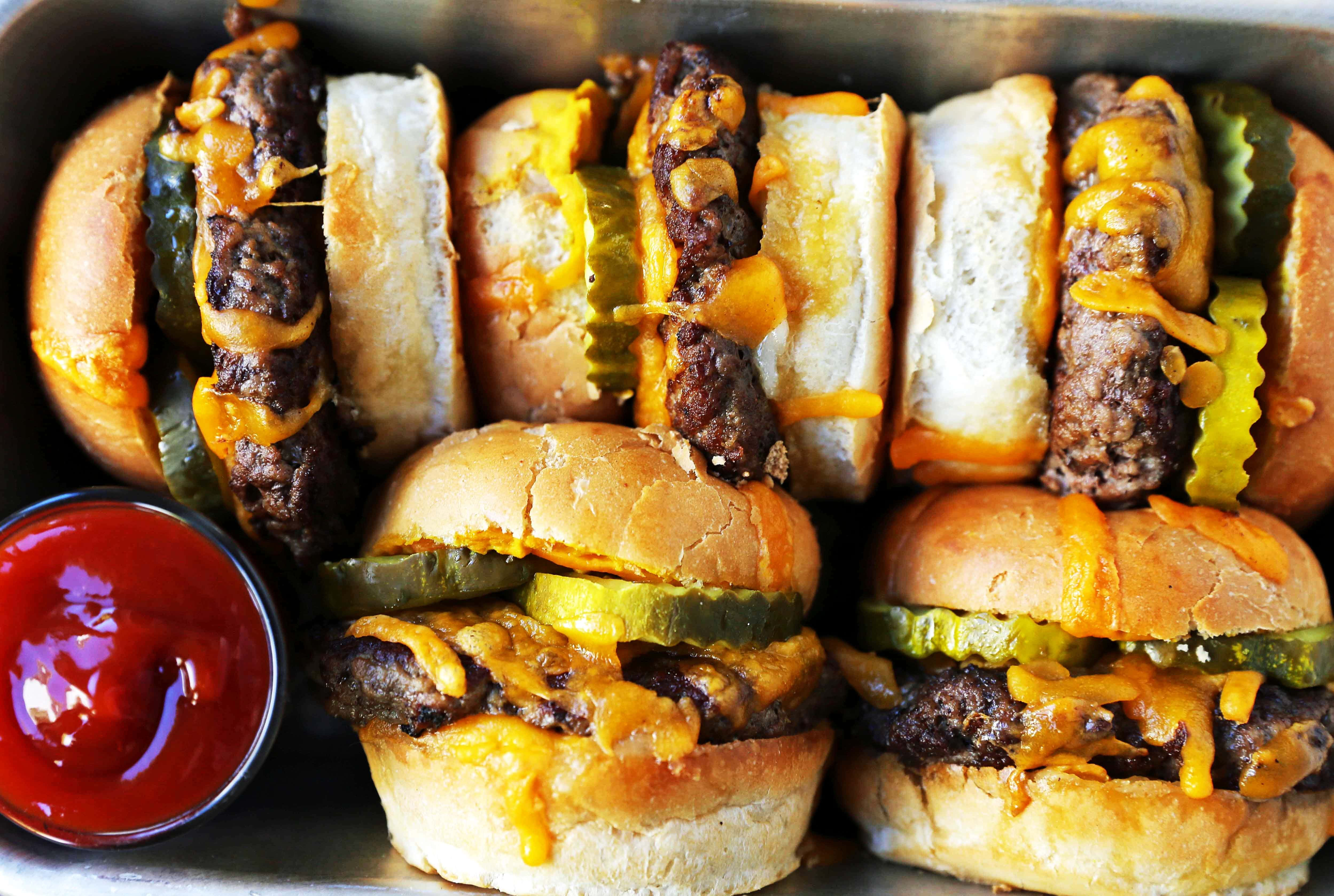 Cheeseburger Sliders. How to make the perfect cheese sliders. Super Bowl food. www.modernhoney.com #sliders #cheeseburgers #hamburgers #burgers #burger