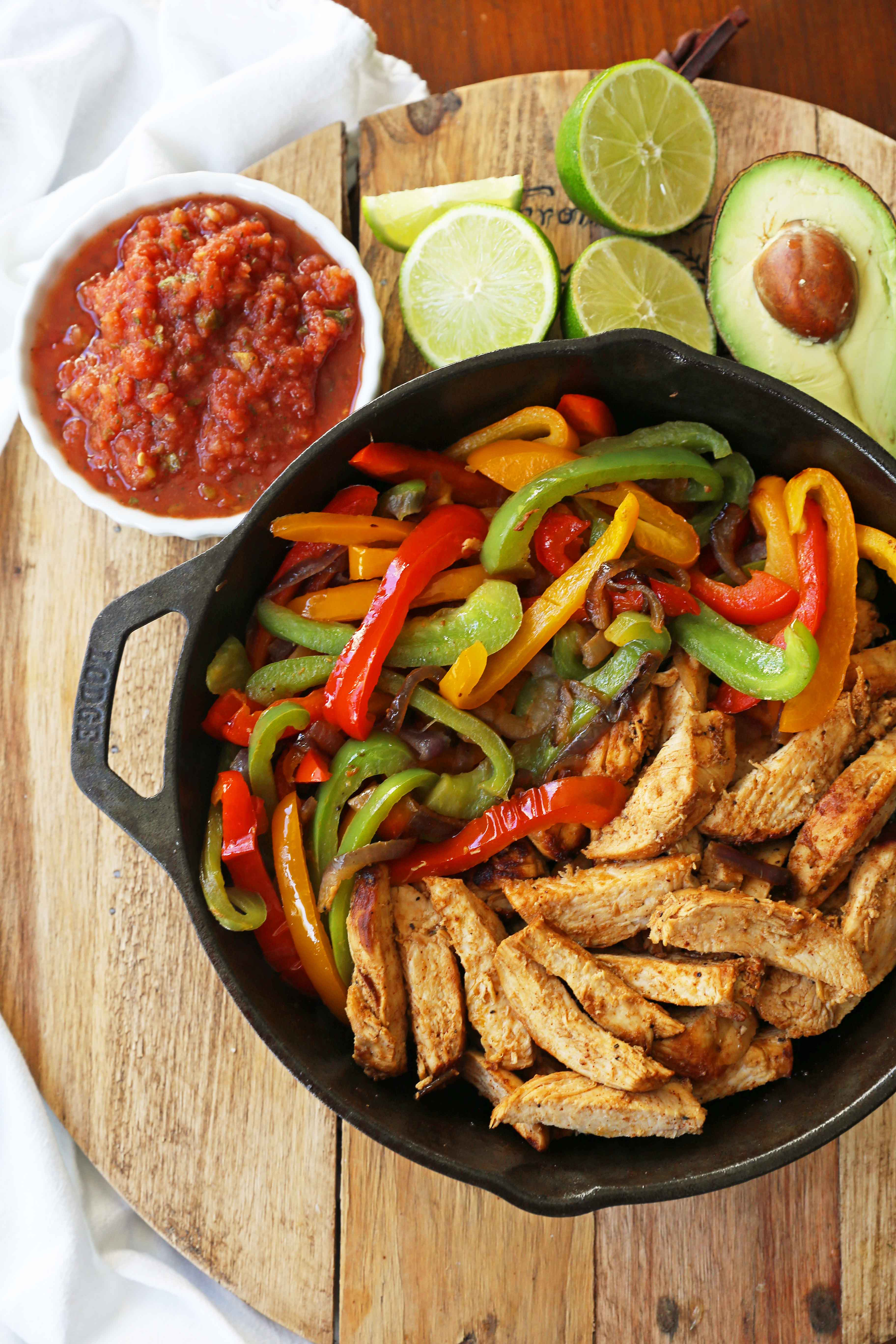 The Best Chicken Fajitas Recipe. Flavorful, juicy, seasoned chicken fajitas with sauteed onions and peppers.  The perfect chicken fajitas recipe! www.modernhoney.com #chicken #chickenfajitas #fajitas #mexican #mexicanfood