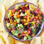 Cowboy Caviar. A popular, crowd-pleasing appetizer made with black beans, corn, tomatoes, cilantro, avocado, peppers, all tossed in a zesty dressing. www.modernhoney.com #cowboycaviar #appetizer #salsa #cornsalsa #blackbeansalsa #appetizers