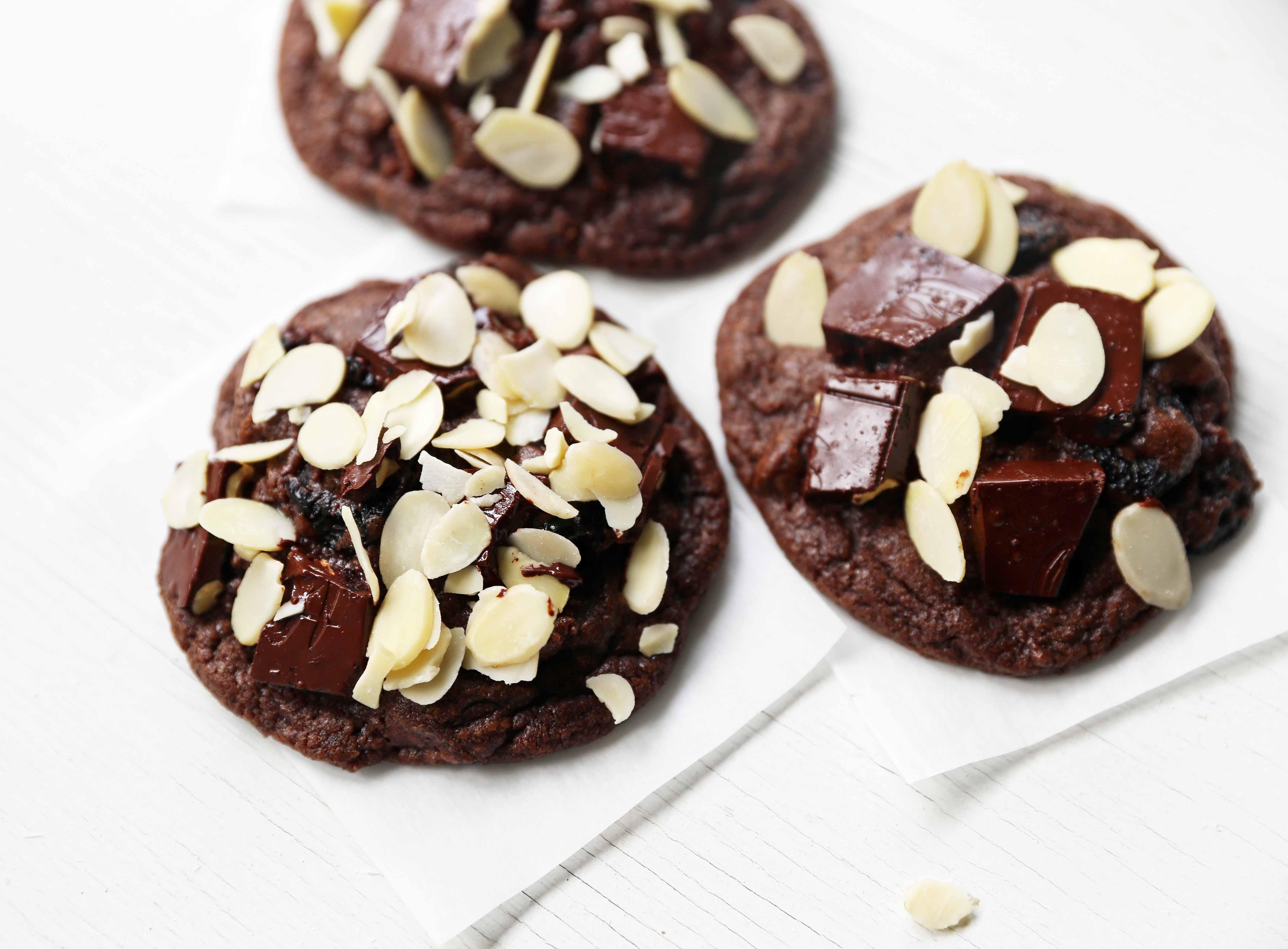 Chocolate Cherry Almond Cookies. Decadent chocolate chunk cookies with dried cherries and sliced almonds. A rich chocolate cherry chunk cookie! www.modernhoney.com #cherrychocolatecookies #chocolatecherrycookies #chocolatecookies #chocolatecookie