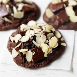 Chocolate Cherry Almond Cookies. Decadent chocolate chunk cookies with dried cherries and sliced almonds. A rich chocolate cherry chunk cookie! www.modernhoney.com #cherrychocolatecookies #chocolatecherrycookies #chocolatecookies #chocolatecookie